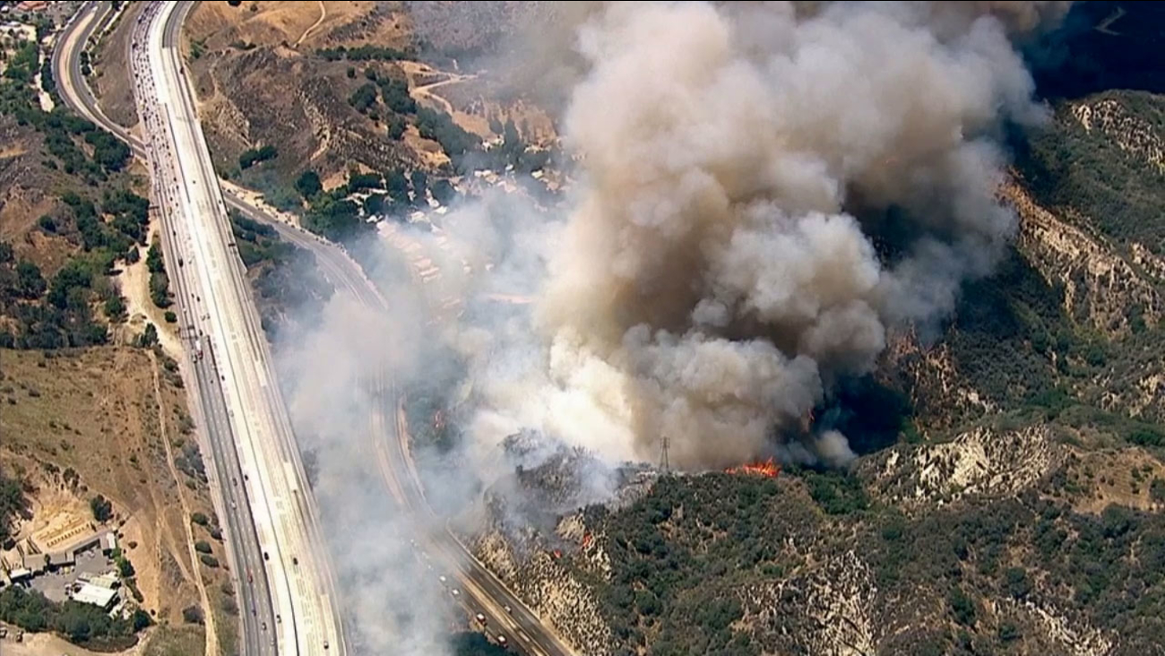 A brush fire erupted next to Calgrove Boulevard and the 5 Freeway in Santa Clarita on Wednesday, June 24, 2015.