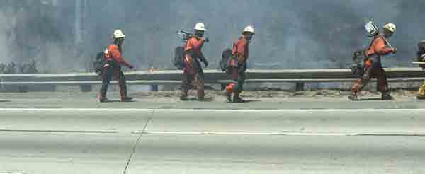 "<div class=""meta image-caption""><div class=""origin-logo origin-image kabc""><span>KABC</span></div><span class=""caption-text"">An ABC7 viewer sent us this photo of firefighters at the scene of a brush fire burning near Calgrove Boulevard and the 5 Freeway in Santa Clarita Wednesday, June 24, 2015.</span></div>"
