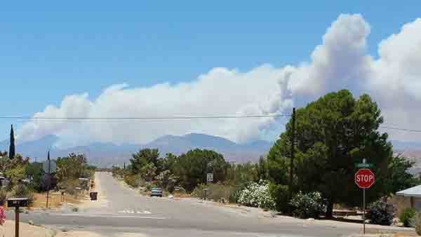 "<div class=""meta image-caption""><div class=""origin-logo origin-image kabc""><span>KABC</span></div><span class=""caption-text"">An ABC7 viewer sent us this photo taken in Joshua Tree of the Calgrove Fire burning in Santa Clarita Wednesday, June 24, 2015.</span></div>"