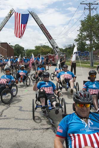 "<div class=""meta image-caption""><div class=""origin-logo origin-image wls""><span>WLS</span></div><span class=""caption-text"">Veterans participating in the Wounded Warrior Project were welcomed at Brookfield Zoo's south entrance on June 25, 2015. (Kelly Tone/Chicago Zoological Society)</span></div>"