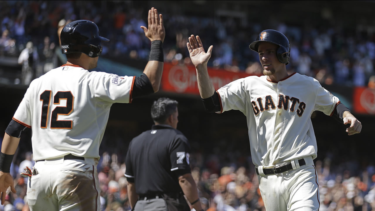 San Francisco Giants' Joe Panik, left, and Matt Duffy celebrate after scoring against the San Diego Padres in the eighth inning on Thursday, June 25, 2015, in San Francisco.