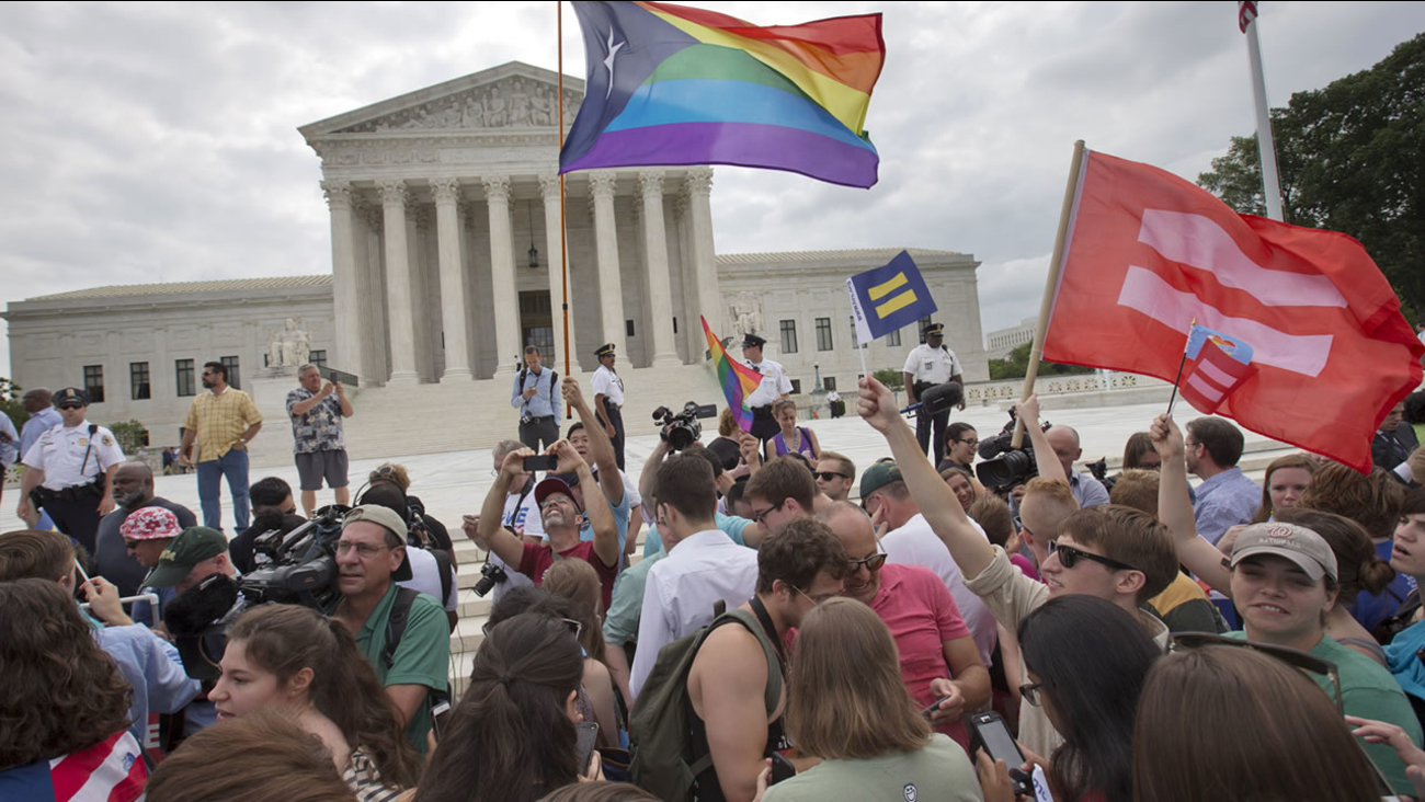 The crowd reacts as the ruling on same-sex marriage was announced outside of the Supreme Court