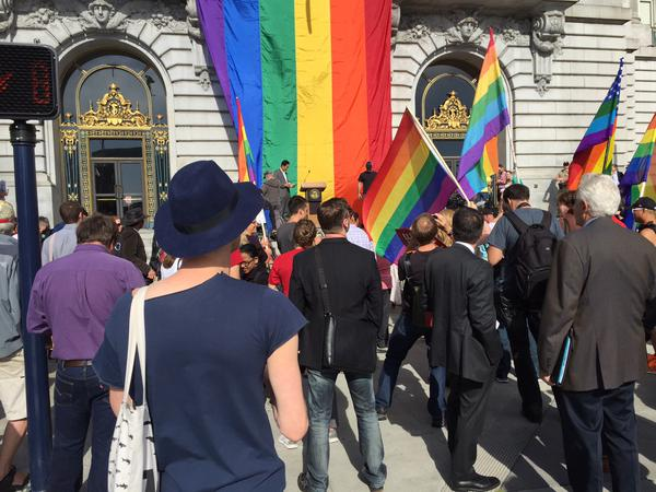 "<div class=""meta image-caption""><div class=""origin-logo origin-image none""><span>none</span></div><span class=""caption-text"">Crowds start to gather at San Francisco's City Hall for Mayor Ed Lee's Presser on SCOTUS ruling on same sex marriages on Friday, June 26, 2015. (KGO-TV)</span></div>"