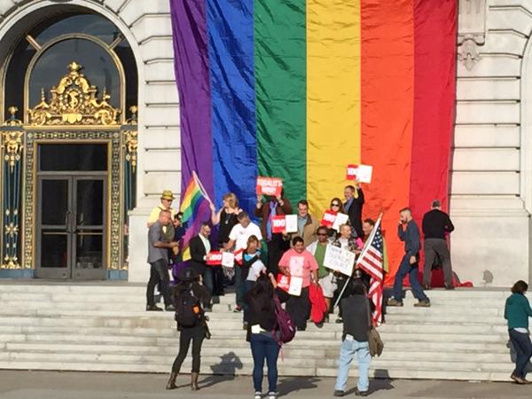 "<div class=""meta image-caption""><div class=""origin-logo origin-image none""><span>none</span></div><span class=""caption-text"">A dozen or so same sex couples gather under the Pride flag which was unfurled at San Francisco City Hall steps after SCOTUS decision on Friday, June 26, 2015. (KGO-TV)</span></div>"