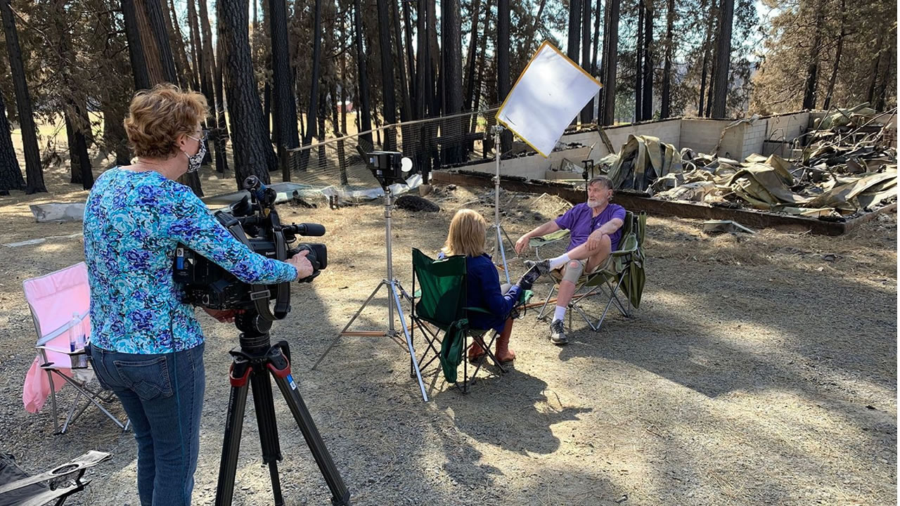 ABC7 photographer Cathy Cavey films an interview between Cheryl Jennings and Camp Okizu co-founder John Bell.