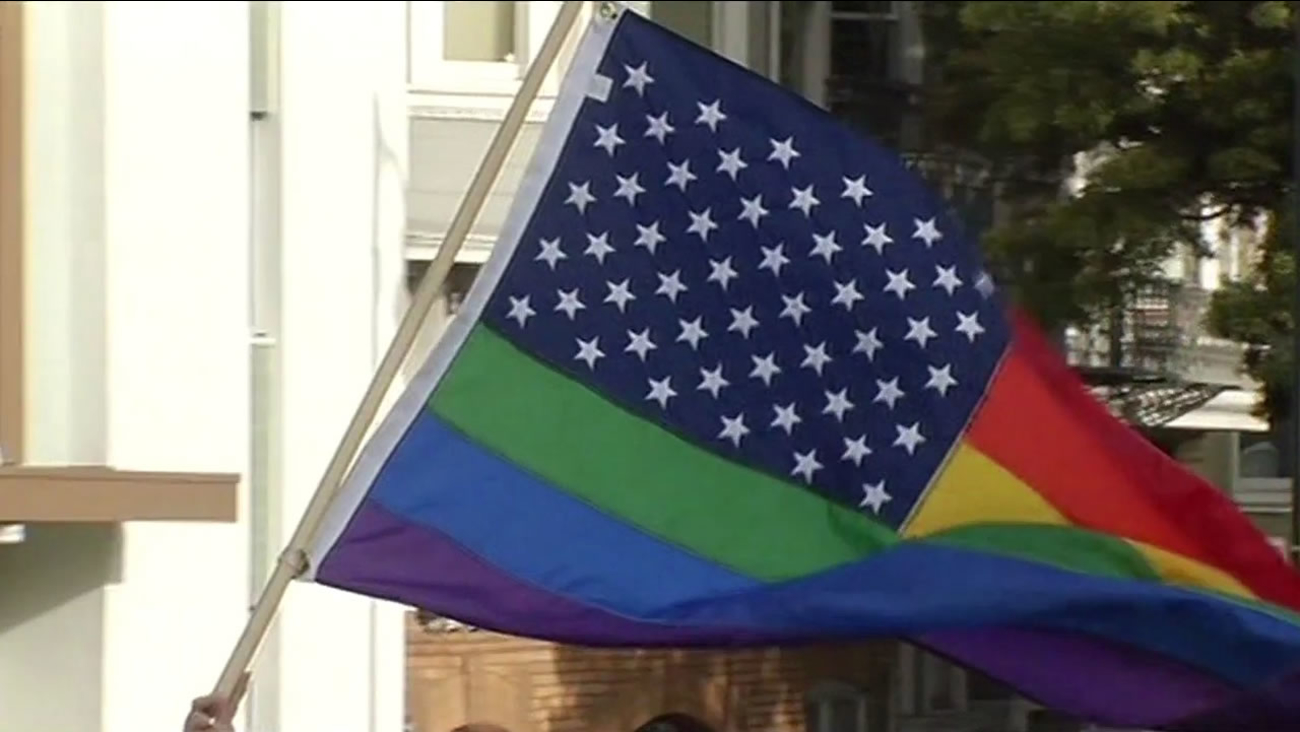 A Pride flag is waved in San Francisco on Friday, June 26, 2015 following the Supreme Court's same-sex marriage ruling.