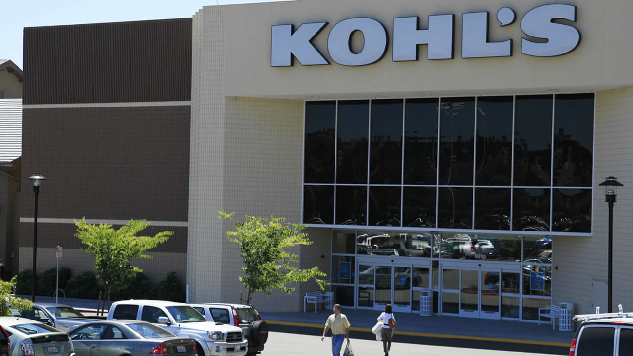 In this Aug. 8, 2011 photo, shoppers enter and exit the Kohl's store in San Rafael, Calif. (AP Photo/Eric Risberg)