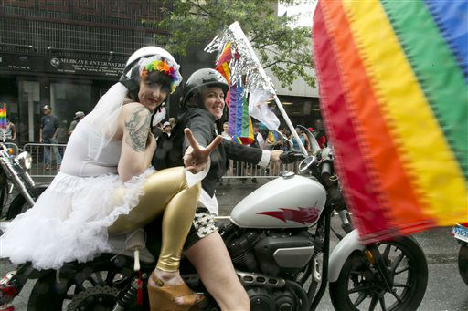 "<div class=""meta image-caption""><div class=""origin-logo origin-image none""><span>none</span></div><span class=""caption-text"">Motorcyclists ride through New York's Greenwich Village in the city's annual Heritage Pride Parade, Sunday, June 28, 2015. (AP Photo/ Mark Lennihan)</span></div>"