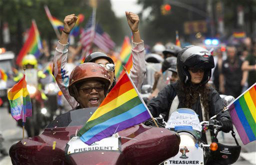 "<div class=""meta image-caption""><div class=""origin-logo origin-image none""><span>none</span></div><span class=""caption-text"">Motorcyclists ride through New York's Greenwich Village in the city's annual Heritage Pride March, Sunday, June 28, 2015. (AP Photo/ Mark Lennihan)</span></div>"
