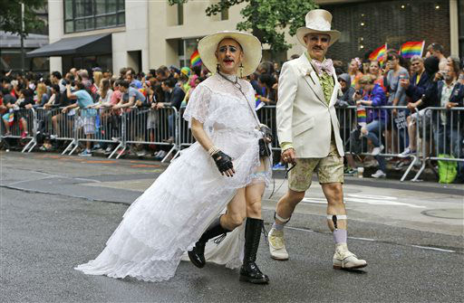 "<div class=""meta image-caption""><div class=""origin-logo origin-image none""><span>none</span></div><span class=""caption-text"">Wearing a wedding gown, ""Tigger!"" Ferguson, left, and his partner Scott Parent walk down Fifth Avenue. (AP Photo/ Kathy Willens)</span></div>"