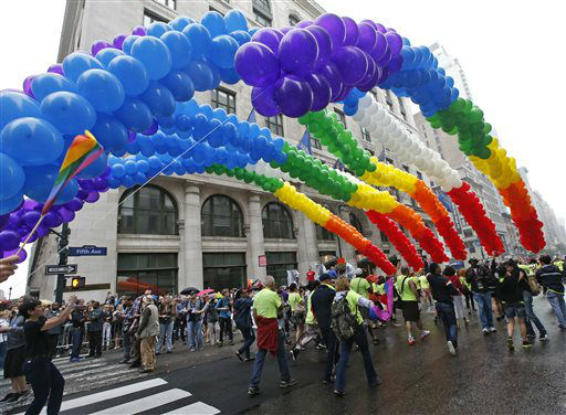 "<div class=""meta image-caption""><div class=""origin-logo origin-image none""><span>none</span></div><span class=""caption-text"">Participants carry rainbow-colored balloons during the Heritage Pride March in New York, Sunday, June 28, 2015. (AP Photo/ Kathy Willens)</span></div>"