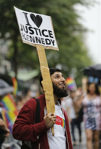 "<div class=""meta image-caption""><div class=""origin-logo origin-image none""><span>none</span></div><span class=""caption-text"">Indian immigrant Anan Farooqi holds a sign professing his love of Supreme Court Justice Anthony M. Kennedy during the Heritage Pride March in New York. (AP Photo/ Kathy Willens)</span></div>"