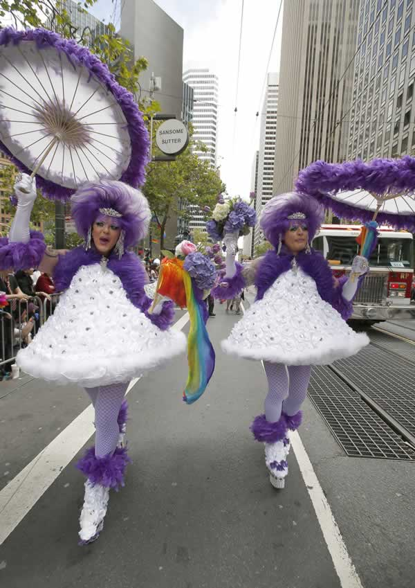 "<div class=""meta image-caption""><div class=""origin-logo origin-image none""><span>none</span></div><span class=""caption-text"">Graham Browlly, left, and Steven Williams, right, perform the parade route during the 45th annual San Francisco Gay Pride parade Sunday, June 28, 2015, in San Francisco. (AP Photo/ Tony Avelar)</span></div>"