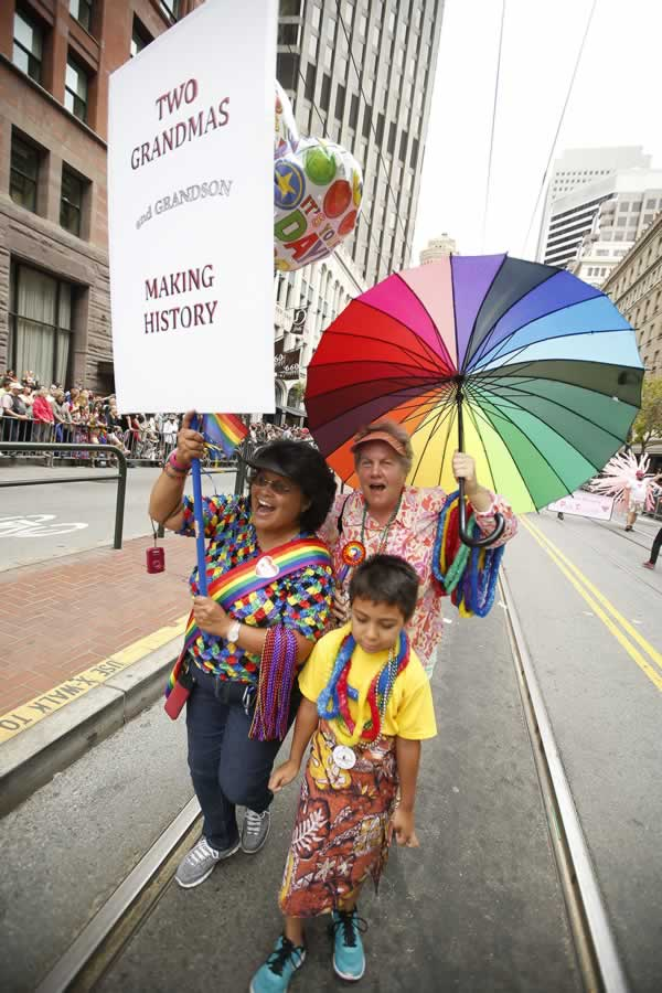 "<div class=""meta image-caption""><div class=""origin-logo origin-image none""><span>none</span></div><span class=""caption-text"">Cathy Camilo, left, and Jayne Duri, married 18 years, walk with their grandson Poto in the 45th annual San Francisco Gay Pride parade Sunday, June 28, 2015, in San Francisco. (AP Photo/ Tony Avelar)</span></div>"
