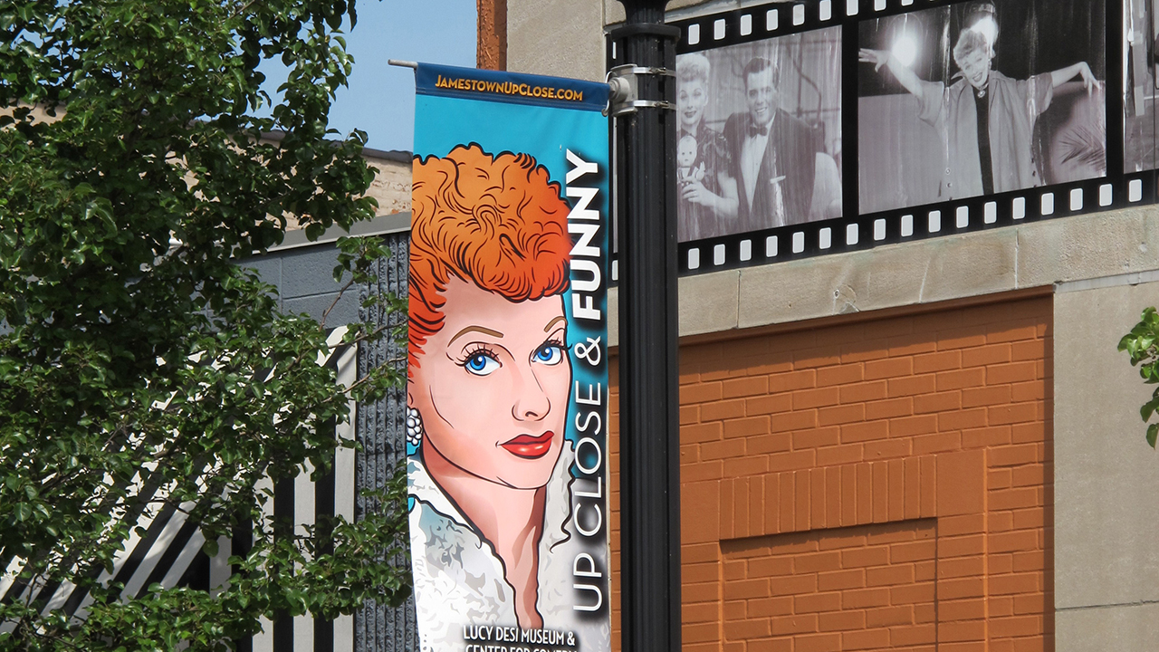 In this June 26, 2015 photo, a banner hangs outside the Lucille Ball-Desi Arnaz Museum in Ball's hometown of Jamestown, N.Y.