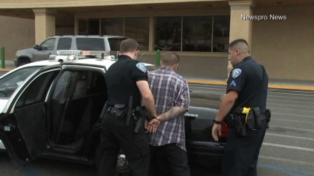 San Bernardino police arrested a man who left his two young children in a hot car in San Bernardino on Sunday, June 28, 2015.