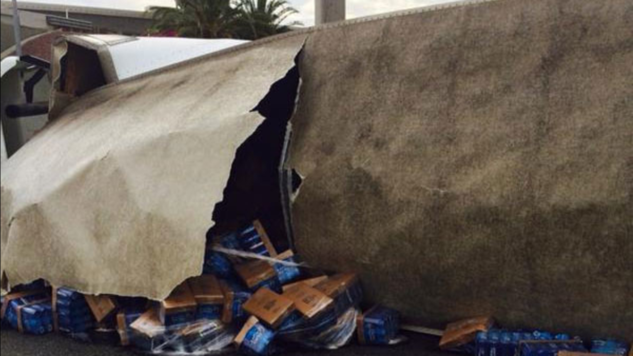 A semi-truck carrying beer overturned on the eastbound 91 Freeway Monday, June 29, 2015.