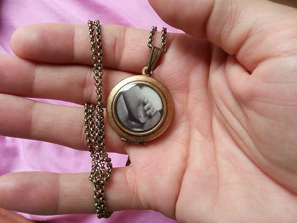 """<div class=""""meta image-caption""""><div class=""""origin-logo origin-image none""""><span>none</span></div><span class=""""caption-text"""">Kim and Fred have a locket with Hudson's photo. They are waiting to have his memorial service until they return. (Photo/Courtesy of Kim Spratt)</span></div>"""