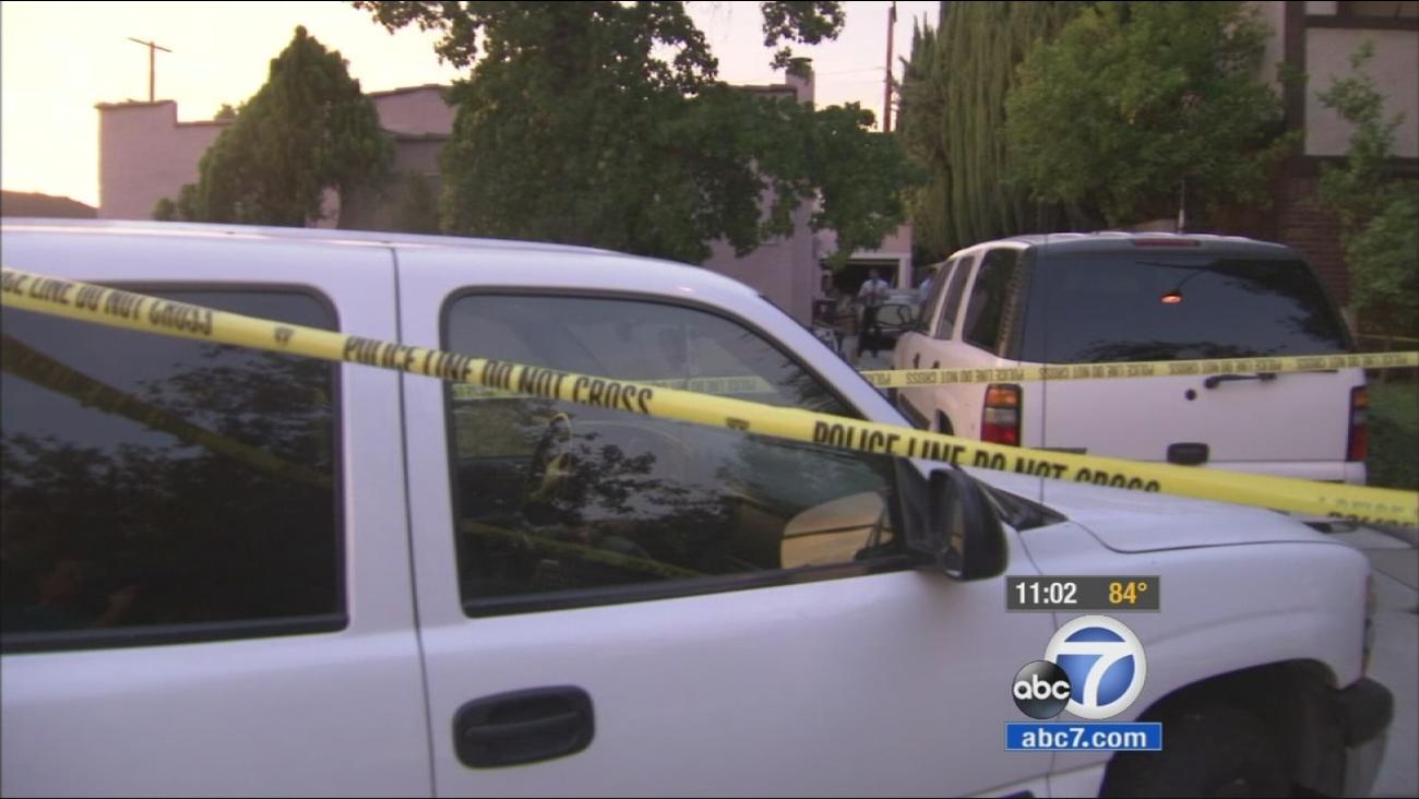 Crime scene tape ropes off the scene, where an elderly couple was found dead in Glendale on Sunday, June 28, 2015.