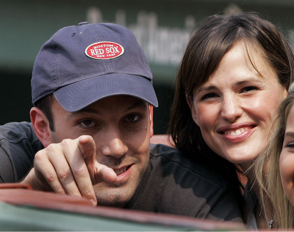 "<div class=""meta image-caption""><div class=""origin-logo origin-image none""><span>none</span></div><span class=""caption-text"">Actor Ben Affleck points while Jennifer Garner smiles as they sit next to the Boston Red Sox dugout  at Fenway Park in Boston Saturday, June 2, 2007. (AP Photo/Elise Amendola)</span></div>"