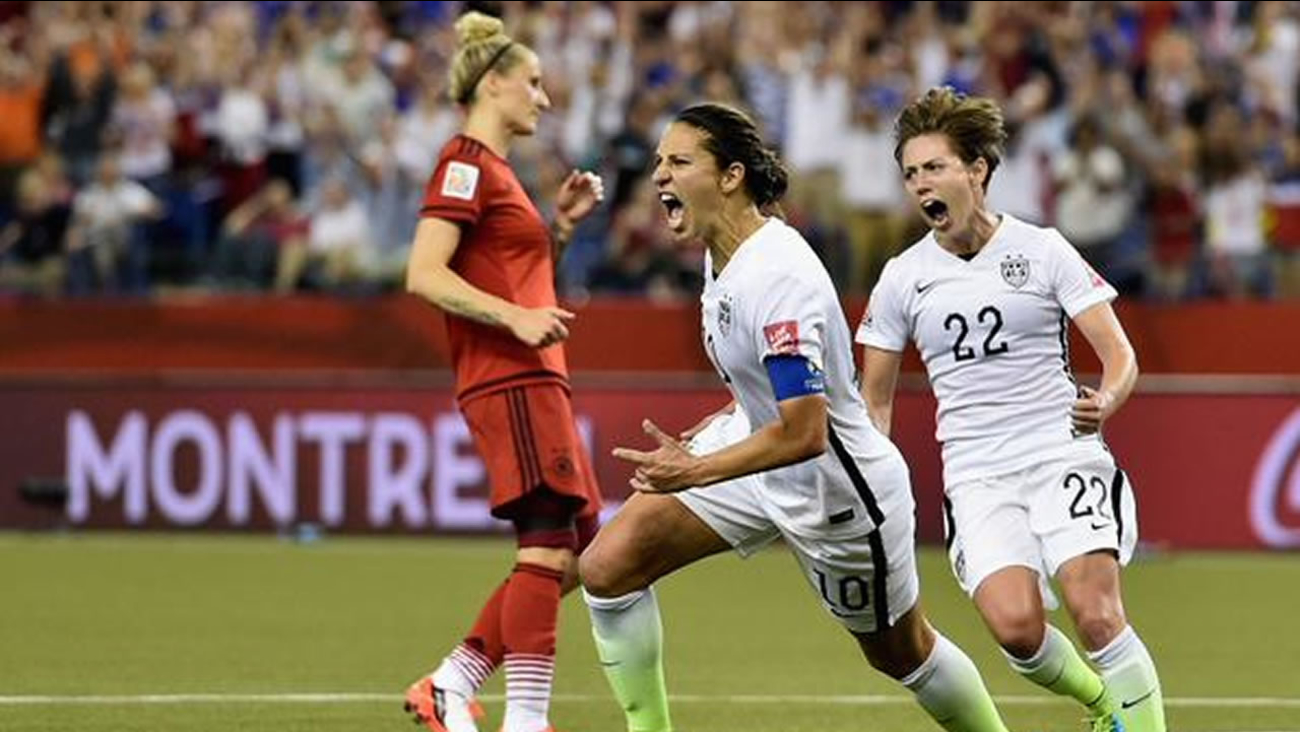US Womens Soccer team cheers as it defeats Germany in Women's World Cup semifinals 2-0, Tuesday, June 30, 2015.