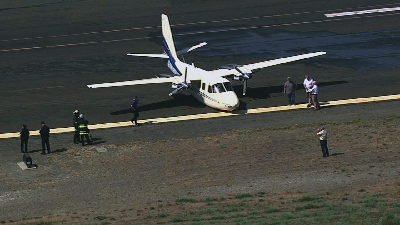 A private plane landed at Hayward airport with no landing gear, Wednesday, July 1, 2015.