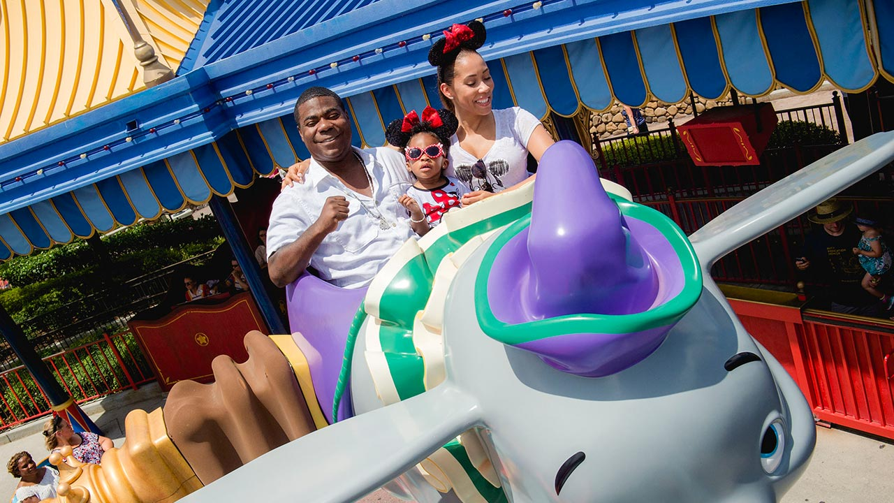 Tracy Morgan, fiancée Megan Wollover and daughter Maven Morgan, 2, take flight July 2, 2015, on Dumbo The Flying Elephant at the Magic Kingdom theme park.