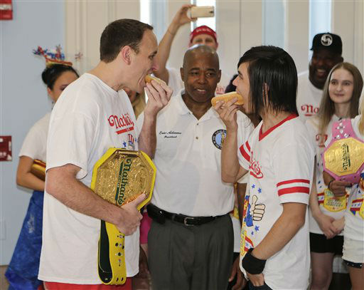 "<div class=""meta image-caption""><div class=""origin-logo origin-image none""><span>none</span></div><span class=""caption-text"">Brooklyn Borough President Eric Adams watches Joey Chestnut, left, and Matt Stonie, right, during a news conference. (AP Photo/ Frank Franklin II)</span></div>"