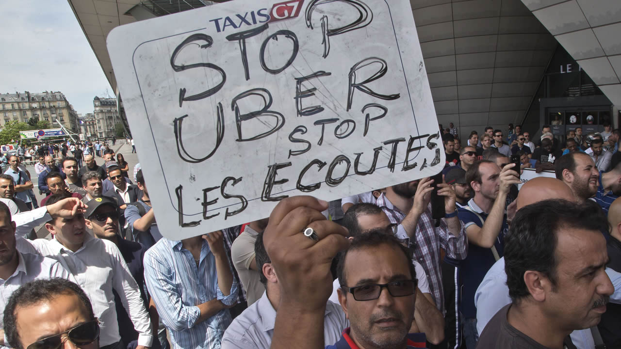 FILE - This Thursday, June 25, 2015 file photo shows a striking taxi driver demonstration in Paris, France.