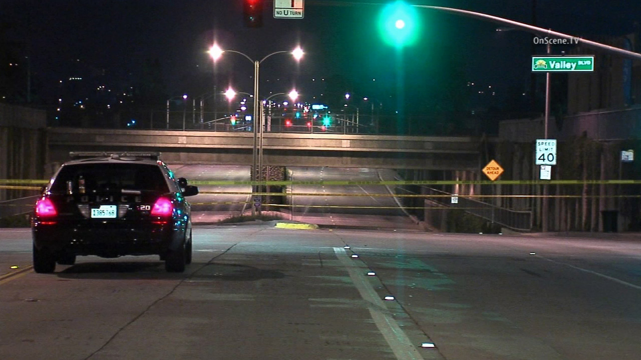 An intersection was cordoned off as sheriff's deputies investigated an officer-involved shooting in West Covina on Friday, July 3, 2015.