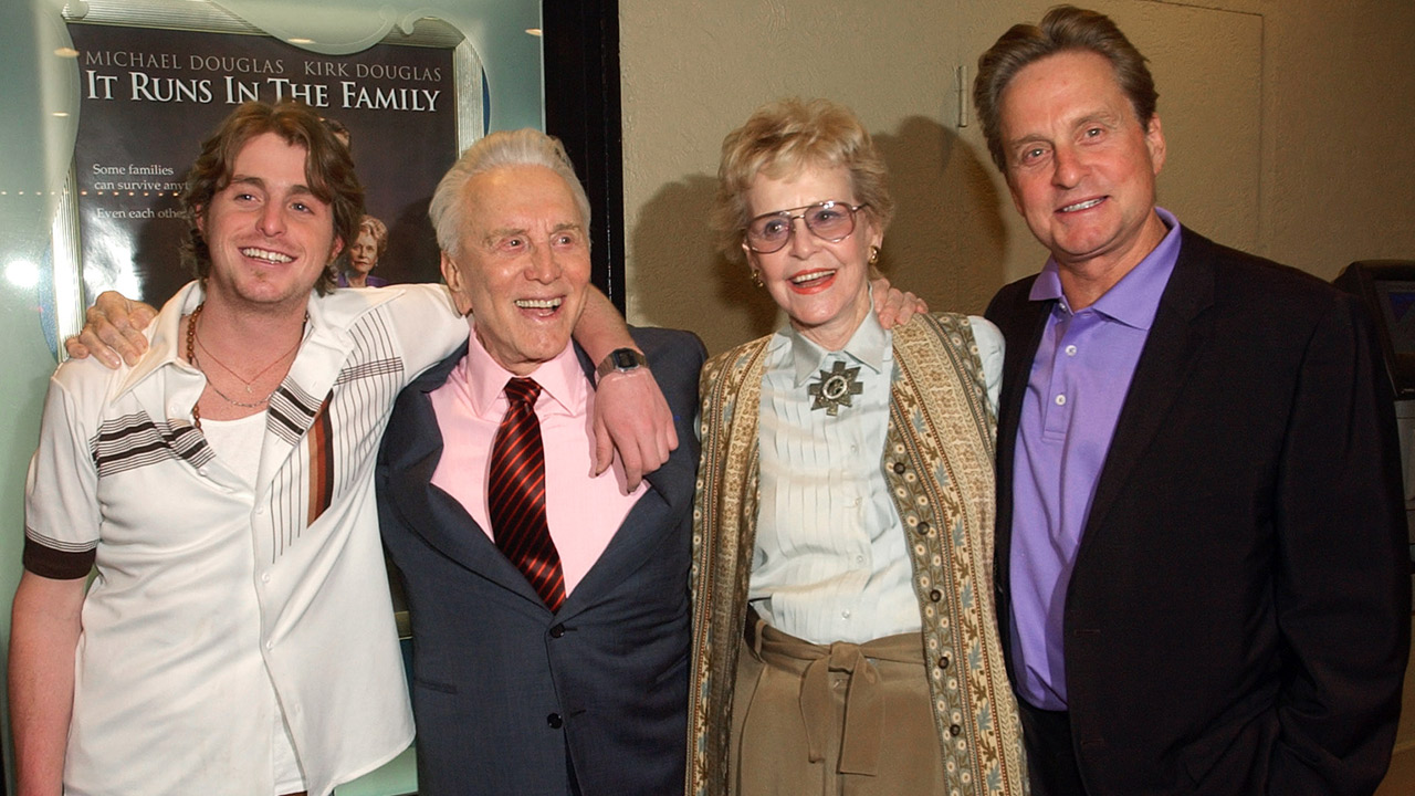 In this April 7, 2003 file photo, actor Kirk Douglas poses with his ex-wife Diana Douglas, their son Michael Douglas and Michael's son Cameron Douglas in Los Angeles.