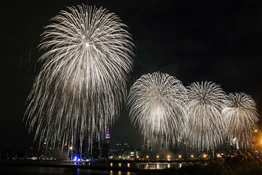 "<div class=""meta image-caption""><div class=""origin-logo origin-image none""><span>none</span></div><span class=""caption-text"">Fireworks explode over the East River in front of the Manhattan skyline as photographed from Brooklyn. (AP Photo/Jason DeCrow) (AP Photo/ Jason DeCrow)</span></div>"