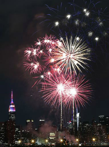 "<div class=""meta image-caption""><div class=""origin-logo origin-image none""><span>none</span></div><span class=""caption-text"">The Empire State Building, left, is illuminated as fireworks explode over the East River. (AP Photo/Jason DeCrow) (AP Photo/ Jason DeCrow)</span></div>"