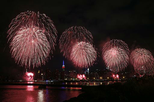 "<div class=""meta image-caption""><div class=""origin-logo origin-image none""><span>none</span></div><span class=""caption-text"">Fireworks explode over the East River in front of the Manhattan skyline as seen from Brooklyn. (AP Photo/Jason DeCrow) (AP Photo/ Jason DeCrow)</span></div>"