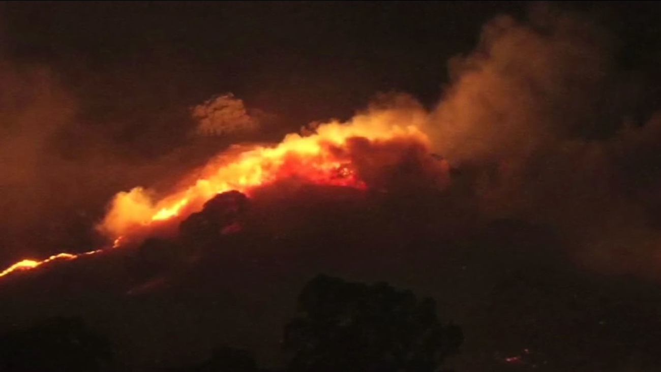 A four-alarm fire burns 320 acres near Keating Park in Vacaville, Calif. on Saturday, July 4, 2015.