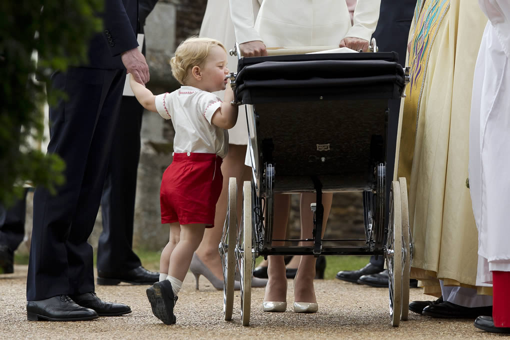 "<div class=""meta image-caption""><div class=""origin-logo origin-image none""><span>none</span></div><span class=""caption-text"">Britain's Prince George peeks into the pram of Princess Charlotte flanked by his parents in Sandringham, England, July 5, 2015. (AP Photo/Matt Dunham, Pool)</span></div>"