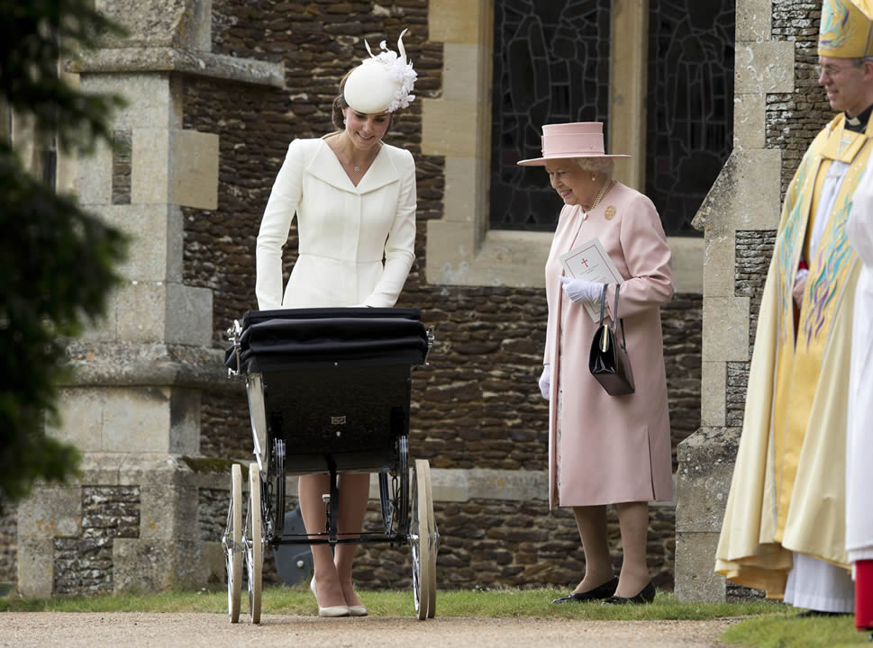 <div class='meta'><div class='origin-logo' data-origin='none'></div><span class='caption-text' data-credit='AP Photo/Matt Dunham, Pool'>Britain's Queen Elizabeth II stands with Kate the Duchess of Cambridge whilst pushing Princess Charlotte at St. Mary Magdalene Church in Sandringham, England, July 5, 2015.</span></div>