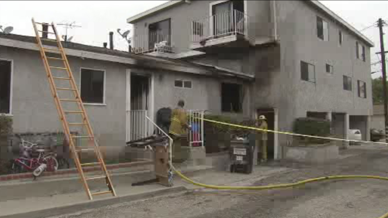 Los Angeles firefighters investigate a fire that broke out at an apartment building in San Pedro on Sunday, July 5, 2015.