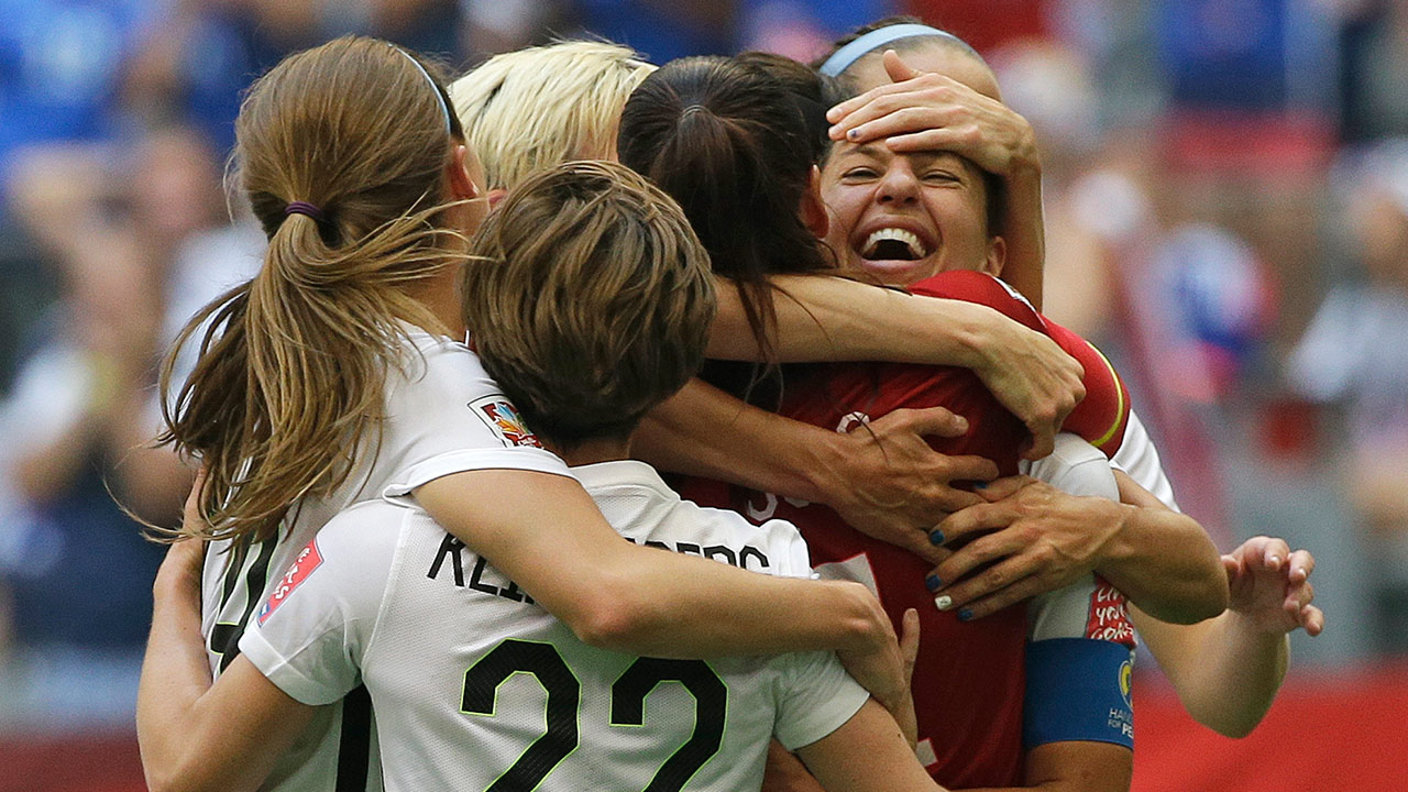 United States' Carli Lloyd, right, celebrates with teammates after Lloyd scored her third goal against Japan during the first half of the FIFA Women's World Cup soccer championship in Vancouver, British Columbia, Canada, Sunday, July 5, 2015.
