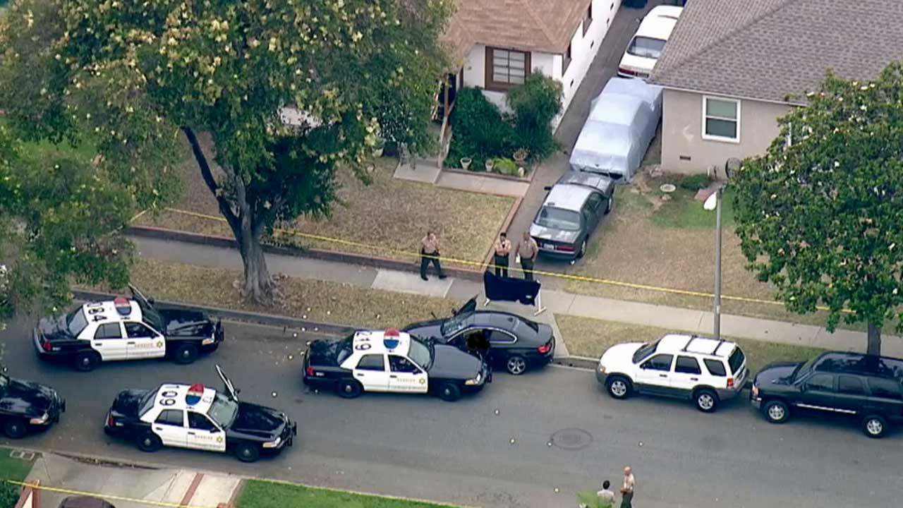 Los Angeles County sheriff's deputies investigate a fatal deputy-involved shooting in the 5500 block of Adenmoor Avenue in Lakewood Monday, July 6, 2015.