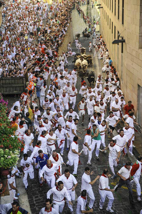 "<div class=""meta image-caption""><div class=""origin-logo origin-image none""><span>none</span></div><span class=""caption-text"">People watch participants run ahead of ''Jandilla'' fighting bulls from Santo Domingo street during the running of the bulls at the San Fermin Festival, in Pamplona, Spain (AP Photo/ Alvaro Barrientos)</span></div>"