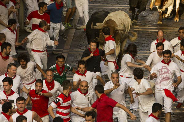 "<div class=""meta image-caption""><div class=""origin-logo origin-image none""><span>none</span></div><span class=""caption-text"">Jandilla fighting bulls and steers run after revelers during the running of the bulls, at the San Fermin festival, in Pamplona, Spain, Tuesday, July 7, 2015. (Photo/Andres Kudacki)</span></div>"