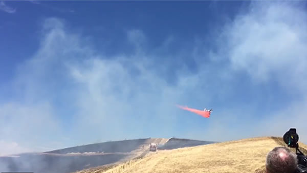This screenshot is from a video tweeted by Contra Costa Co. Fire of a two-alarm, 35-acre vegetation fire that burned near Evora Rd. in Bay Point, Calif. on Tuesday, July 7, 2015