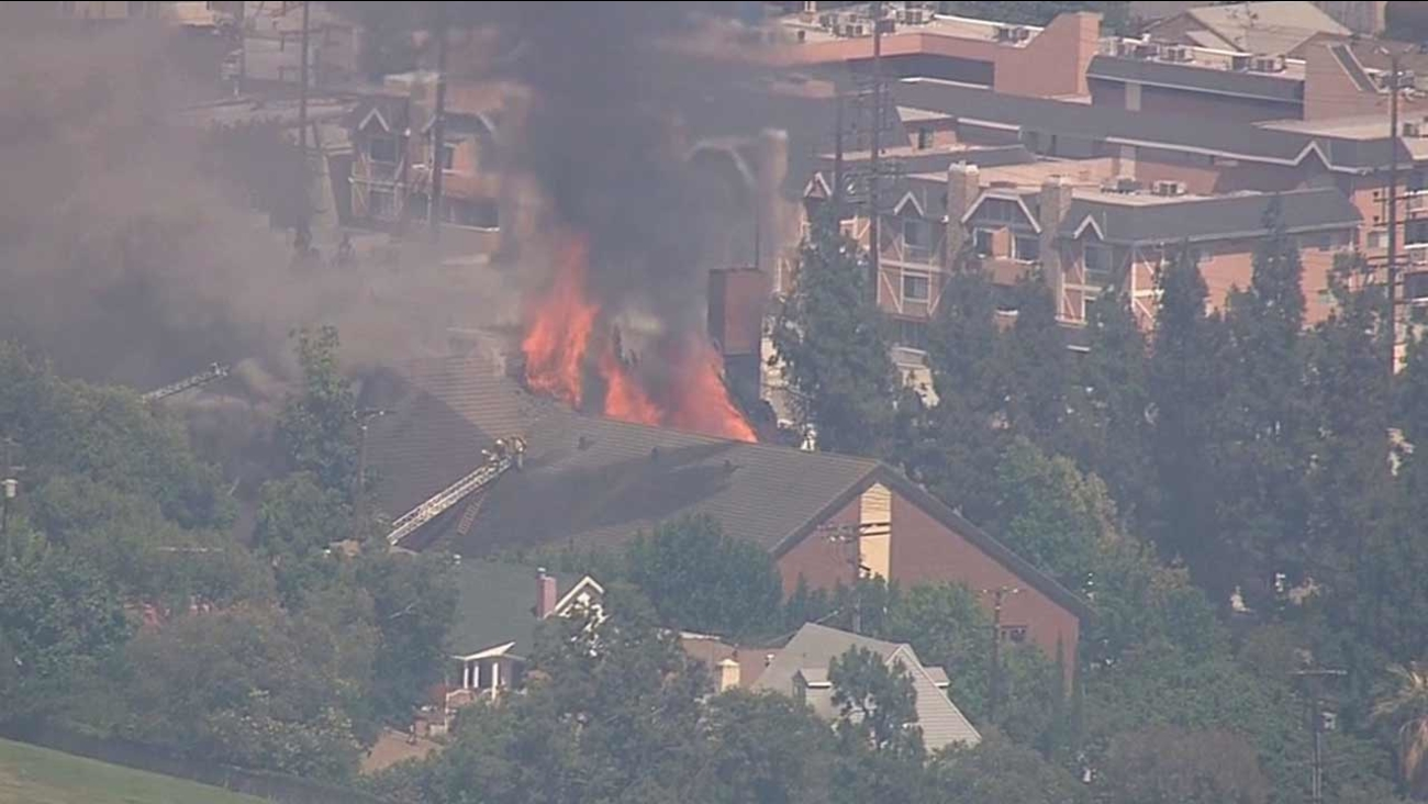 Firefighters battle a fire in the attic of a church in the 3900 block of Roderick Road in Glassell Park Tuesday, July 7, 2015.