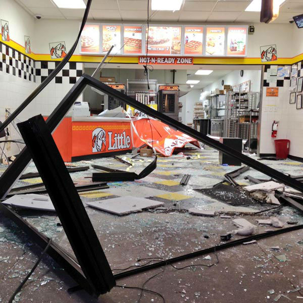 """<div class=""""meta image-caption""""><div class=""""origin-logo origin-image none""""><span>none</span></div><span class=""""caption-text"""">Houston Police say a group of thieves escaped with a big safe after backing a pickup truck into the front of a Little Caesars. (KTRK Photo)</span></div>"""