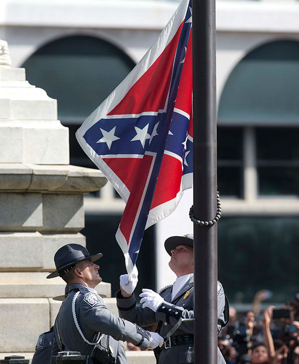 """<div class=""""meta image-caption""""><div class=""""origin-logo origin-image none""""><span>none</span></div><span class=""""caption-text"""">An honor guard from the South Carolina Highway patrol removes the Confederate battle flag from the Capitol grounds in Columbia, S.C. (AP)</span></div>"""