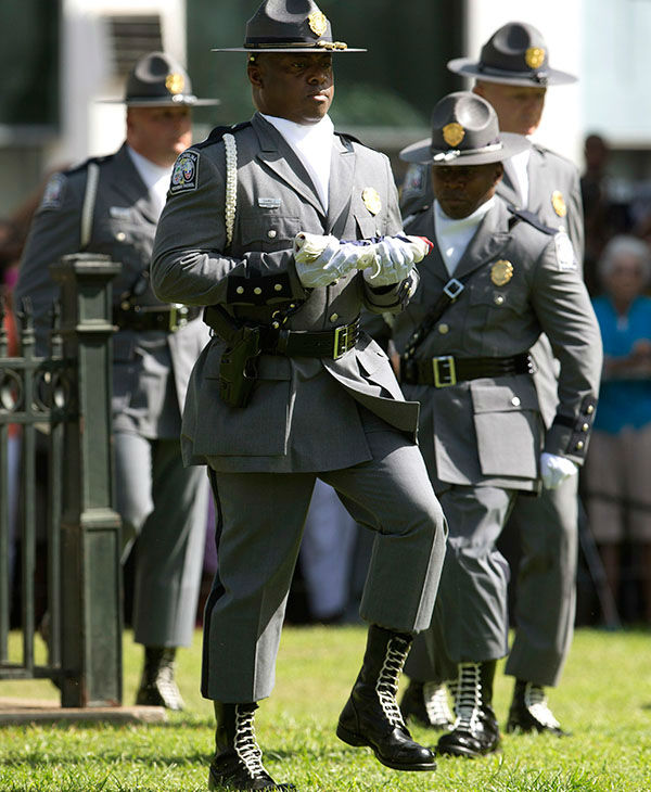 """<div class=""""meta image-caption""""><div class=""""origin-logo origin-image none""""><span>none</span></div><span class=""""caption-text"""">An honor guard from the South Carolina Highway patrol removes the Confederate battle flag from the Capitol grounds Friday, July 10, 2015, in Columbia, S.C. (AP)</span></div>"""