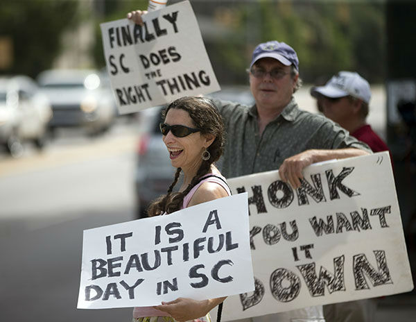 """<div class=""""meta image-caption""""><div class=""""origin-logo origin-image none""""><span>none</span></div><span class=""""caption-text"""">Leslie Minerd, of Columbia, S.C., holds a sign as she celebrates outside the South Carolina Statehouse, Thursday, July 9, 2015, in Columbia, S.C. (AP)</span></div>"""