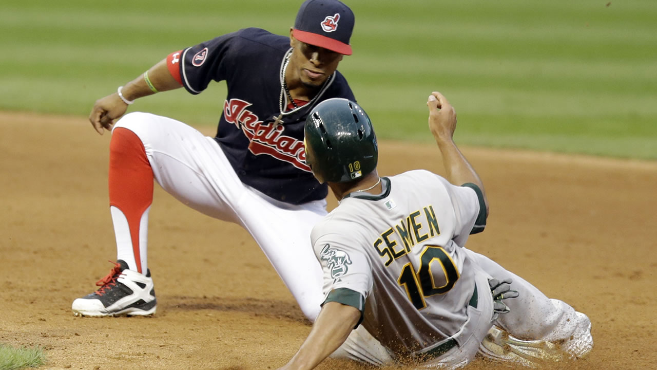 Oakland Athletics' Marcus Semien slides into second base