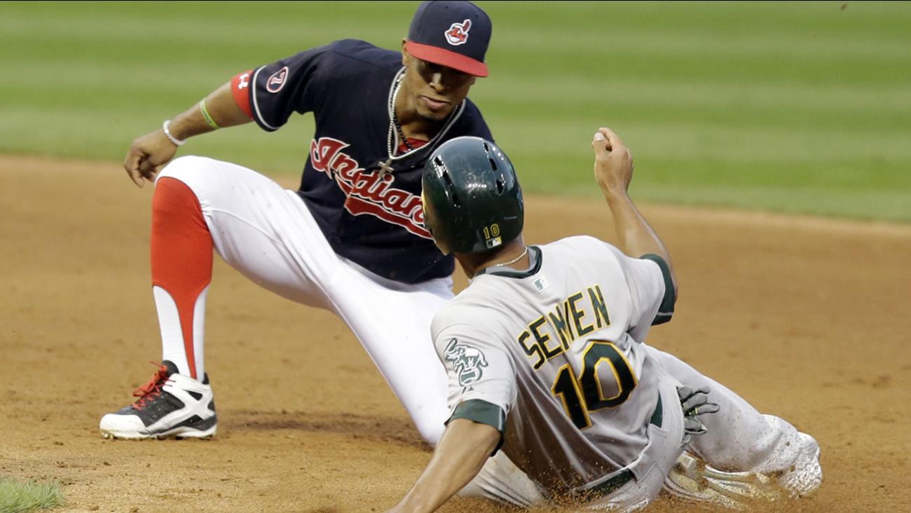 Oakland Athletics' Marcus Semien slides into second base